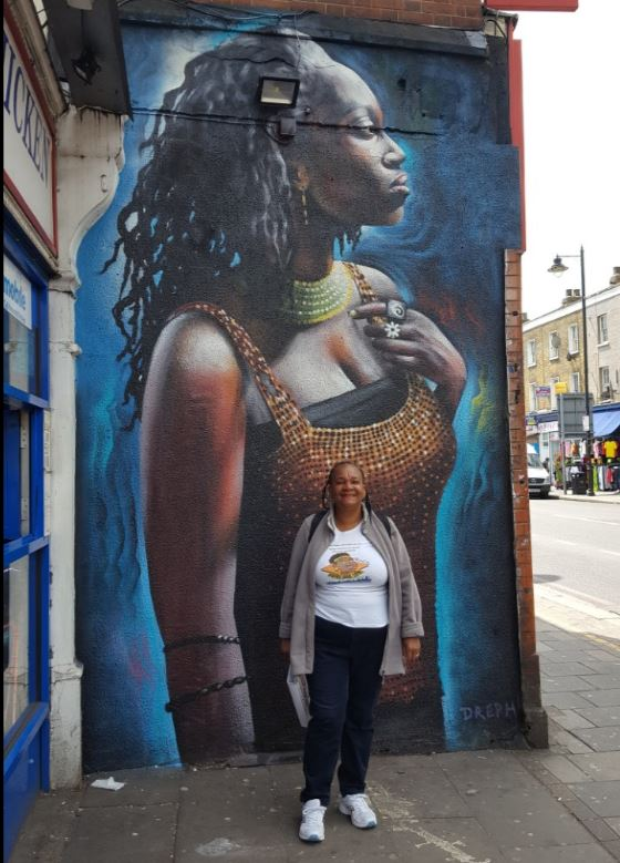 Avril in front of Dreph mural Tottenham